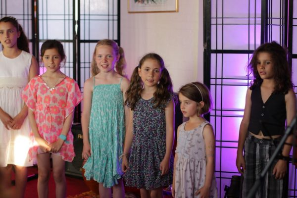 """Children of the World Heart Beat Music Academy perform """"Champions of the World"""", an original piece under the direction of Daisy Chute"""