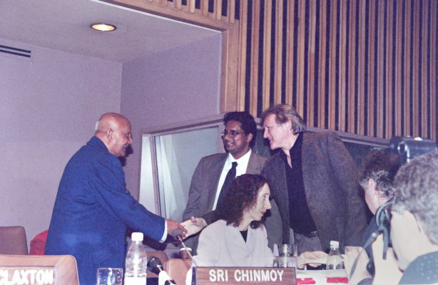 """Left to right: Sri Chinmoy, Ram Devineni, James Ragan and Joyce Carol Oates on the podium at """"Celebrating the UN Year of Dialogue Among Civilizations through Poetry"""", 29 March 2001"""