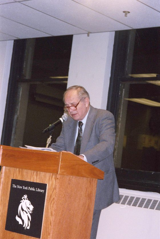 "George Dickerson reads his poetry at the ""UN at 60"" celebratory reading in honour of the 60th Anniversary of the United Nations (Mid-Manhattan Library, 40th St. and Fifth Avenue, 24 October 2005)."